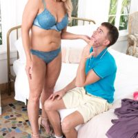 Hot blonde granny Chery Leigh flashes a younger boy while seducing him