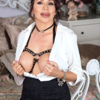 Hot granny Lisa Marie Heart seduces a younger man in a choker and bondage harness