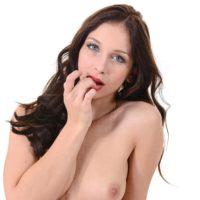 Sexy brunette model Ann O Fee finger fucks her pussy after removing her red bikini