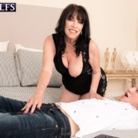 60 plus MILF Christina Starr seduces a young man while going braless in a black dress