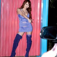 Asian MILF Hitomi flashes upskirt panties in thigh high boots during solo action