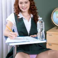 Barely legal redhead Alice Green strips naked during her schoolgirl studies
