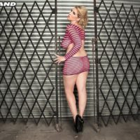Blonde MILF Rockell frees her big natural tits from a revealing dress in solo action