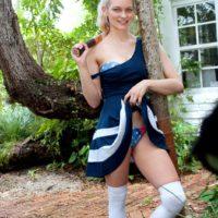 Blue eyed blonde teen Alli Rae flashes her big tits outdoors in a thong and OTK socks