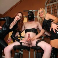 Clothed women Zoey and Kendra deny a hooded male sub from having an orgasm
