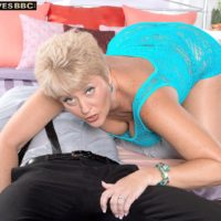 Horny granny Tracy Licks seduces a younger black man in a see through dress