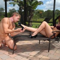 Hot wife Callie Calypso makes her submissive husband worship her feet by a pool
