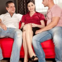 Mature MILF Lorenzia has her pussy and ass fondled by her younger lovers on a sofa