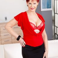 Over 60 redhead Caroline Hamsel plays with her breasts wearing crotchless panties