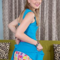 Sweet teen Lily Rader flashes her cute panties before showing her tiny tits