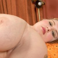 Tattooed BBW Miss Isabelle strips off her satin lingerie and panties in solo action