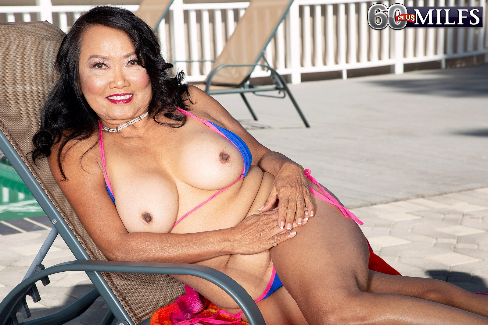 60 Plus Asian MILF Mandy Thai peels off a string bikini to get naked by a pool