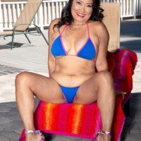 60 Plus Asian MILF Mandy Thai peels off a string bikini to get naked by a pool