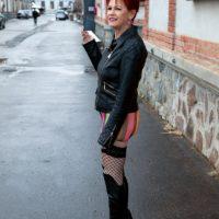 60 plus redhead Caroline Hamsel seduces a couple of boys on the street in slutwear