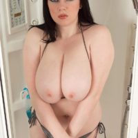 Chubby MILF Emily Cartwright pinches her nipples after loosing hooters from a bikini