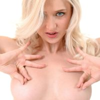 Cute blonde Nika N casts off sexy lingerie to stand naked and barefoot in solo action