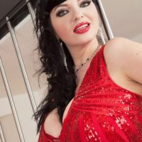 Dark haired model Joana Bliss sets her great tits free of a short red dress in red heels