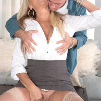 Hot mature woman Dallas Matthews exposes her lace panties while seducing a man