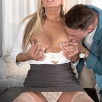 Hot mature woman Dallas Matthews exposes her lace panties while seducing a man