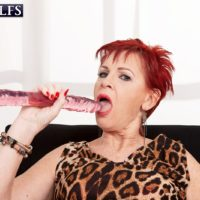 Redhead granny Caroline Hamsel licks and sucks her collection of sex toys in panties