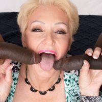 Sexy blonde granny Seka Black sucks on a couple of big black dicks during MMF sex