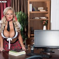 Sexy blonde schoolgirl Katie Thornton pinches her nipples after baring her huge tits