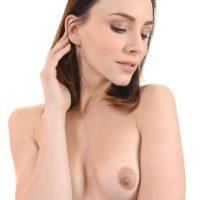 Solo model Adel Morel toys her shaved pussy after stripping off black lingerie