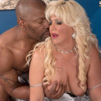 Thick mature blonde Lori Suarez frees her big ass from silk lingerie for her black lover