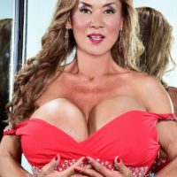 Asian solo model Minka releases her massive breasts from a red dress afore a mirror