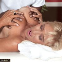 Busty blonde granny Brittney Snow has her boobs played with by her black masseur