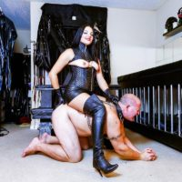 Dark haired woman Michelle Lacy dominates her subby hubby slave in thigh highs