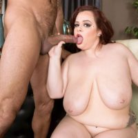 Fat redhead Jordynn LuXXX licks a big dick after her huge tits and big ass are groped