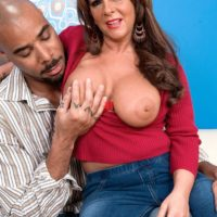 Hot granny Cassidy has her big boobs fondled while a black man undresses her