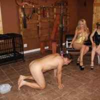 Kimber Woods and a hot girlfriend pee into a bowl held by a collared male sub