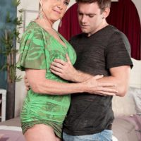 Mature lady Honey Ray sports short blonde hair while tugging on a young boy's cock
