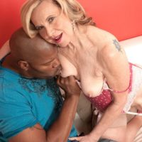Petite granny Miranda Torri has her nipples licked by her younger black lover