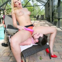 Sexy blonde Vanessa Cage faces sits the pool boy while topless on a deck in red pumps