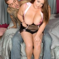 BBW Hillary Hooterz has her big boobs and butt freed from sexy lingerie on a bed