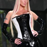 hot blonde domme Alexia Jordon straddles a hooded male slave in latex by the pool