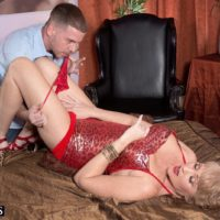 Hot older lady Tracy Lick is freed from a tight dress before having her nipples licked