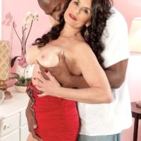 leggy granny Rita Daniels seduces a younger black man in a short red dress and heels