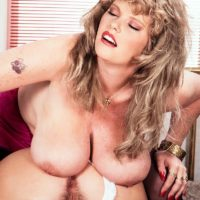 lesbian pornstar Cathy Patrick and her girlfriend play with each other large breasts