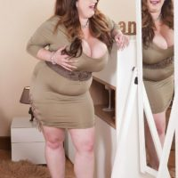 Overweight redhead Anna Beck looses her giants boobs from a dress afore a mirror
