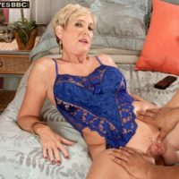 Sexy blonde granny Honey Ray has her pussy licked out by a younger black man
