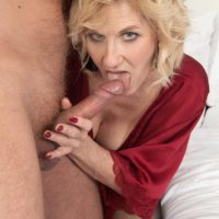 Blonde cougar Molly Maracas licks her younger lover's cock after he brings her wine