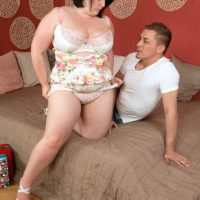 BBW Sarah Jane gets banged missionary style on a bed after being freed from clothes
