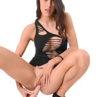 Beautiful brunette Carolina Abril toys her pussy in a revealing dress and high heels