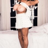 Famous pornstar Busty BriAnna plays with her nipples while showing her large boobs