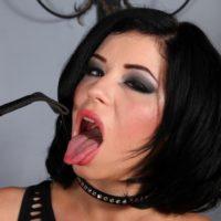 Hot brunette Belle Noir smacks her phat ass with a crop in a revealing black dress