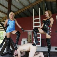 Hot dommes Cherry Morgan and Kylie Rogue use a male slave as bench to sit upon